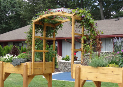 Traditional Style in Red Cedar with Arched Trellis design